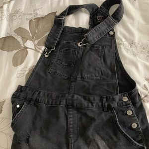 Black ripped overalls